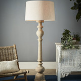 A beautiful turned wooden floor lamp in a chess-piece like form. The lamp is raised on a square foot and finished with a square shade.