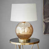 Hand-blown into a timeless ball shape, the Lustre Ball Table Lamp has a stone effect through the glass giving it a wonderful organic texture, while the lustre of the glass finishes it into an elegant lamp. Gold