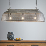 A rustic perforated pendant light with an industrial feel. This pendant is designed to patina over time for a vintage aesthetic.  Zinc