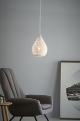 The Moroccan Teardrop pendant features a delicately-patterned perforation in a teardrop shape. Small