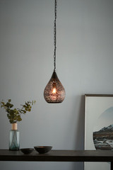 Moroccan Teardrop features a delicately-patterned perforation in a teardrop shape. Small