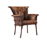 The Navajo chair is handcrafted in sustainable palmwood. Shown here, upholstered in dark brindle Brazilian hide. Featuring a ribbed back design that echoes ancient canoe structures. Built to last with leather bindings & a cushioned back & lumbar support. The wood is harvested from Pacific Island coconut plantations using sustainable practices. 3/4 view