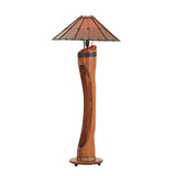 Our Hacienda Floor Lamp is handcrafted from a solid coconut trunk and leather.