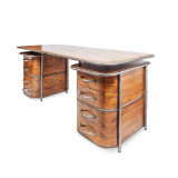 Art Deco Desk - feeling like a little luxury in the workplace? This beautiful timber double pedestal desk with aged steel detail and drawer handles will be a talking piece, and has plenty of space for making those important deals. Deco meets soft industrial in this feature desk. Three quarter view - front.
