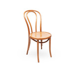 A classic Bentwood style bistro dining chair that works well across a variety of dining room styles. This chair replicates the original No.14 Chair design which uses the furniture making method developed by Michael Thonet in 1859. 3/4 view