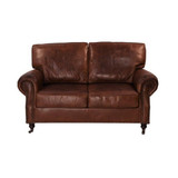 Kingsley 2 Seat Leather Sofa - add classic luxury with this aged leather two seat sofa. Sink in to the generous cushions and relax - suits traditional, vintage and eclectic design themes. Front