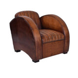 Bentley Leather Armchair - this retro armchair in waxed caramel top grain leather references the luxury car bucket seats of the 40s and 50s. Featuring channel stitching detail, round arms and deeply cushioned back and seat, this is the ultimate club leather armchair. Three quarter view.