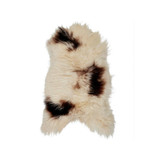 Icelandic Sheepskin Brown Spot. Add warmth, texture and luxury to your space with this naturally silky soft long haired Icelandic Merino sheepskin throw rug brown spot. Front view.