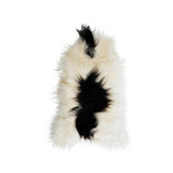 Icelandic Sheepskin White with Black Spot. Add warmth, texture and luxury to your space with this naturally silky soft long haired Icelandic Merino sheepskin throw rug in white with black spot. Front view.