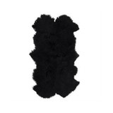 Mongolian Sheepskin Throw Black. Add warmth, texture and luxury to your space with this naturally silky soft sheepskin throw rug in black. Front view.