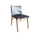 Teak dining chair with full sweep of black leather and a relaxing semi-reclining posture. Front view