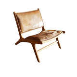 This gorgeous teak and genuine cowhide chair is designed for deep relaxation.