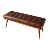 Luxurious and plush buttoned leather bench seat with solid teak frame. Angle view