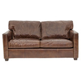 The West End 2 seater sofa is upholstered in our signature aged leather. Featuring deep cushions on the seat and back for extra comfort, complete with brass stud detailing and timber legs. A contemporary design that will bring character to your lounge, office or library.  Front