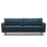 The Harlequin 3 seater sofa is a classic 1960's inspired design to suit both vintage and contemporary interiors. Featuring soft foam back cushions for support and comfort. The Harlequin can be ordered in the fabric as shown, or customise with your own choice of fabric. Front