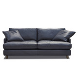 The Rydell 2.5 leather sofa was designed with the 70's in mind. Upholstered in fine-grain New Zealand leather, featuring deep seated comfort with plush feather filled cushions, turned timber legs and modern shelter arms. The Rydell will suit contemporary interiors. leather