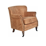The Vintage Leather Armchair is upholstered in stone tumbled aged leather that creates an organic soft finish. 3/4 view