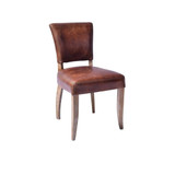 Our Detroit Vintage Chair is upholstered in a waxed aged leather with gold stud detailing around the back of the chair. It embraces a classic style with old age charm & comfort. Will look seamless around any dining table or as a sophisticated office chair. 3/4 view
