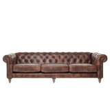 The Eastside leather Chesterfield 4 seater sofa is inspired by iconic British design, for timeless style. Upholstered in distressed leather, featuring diamond buttoning, brass stud detailing, high rolled arms and turned timber legs. Front