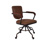 The Desk Chair in Vintage Brown exudes a classical, vintage style. Upholstered in vintage brown faux leather with a steel frame and a versatile, extendable seat height. This chair will liven up your home office or study. 3/4 view