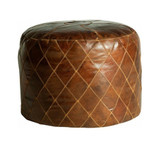 Our Whiskey Round Leather Ottoman is the perfect addition to your living room or bedroom, adding a stylish & versatile element to any room.