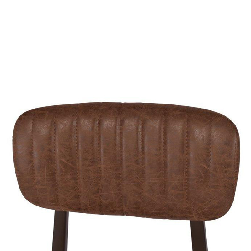 Our Clever Chair in Vintage Brown exudes a classical, vintage style. Upholstered in vintage brown faux leather with a steel frame that will liven up any office or dining space. Close-up