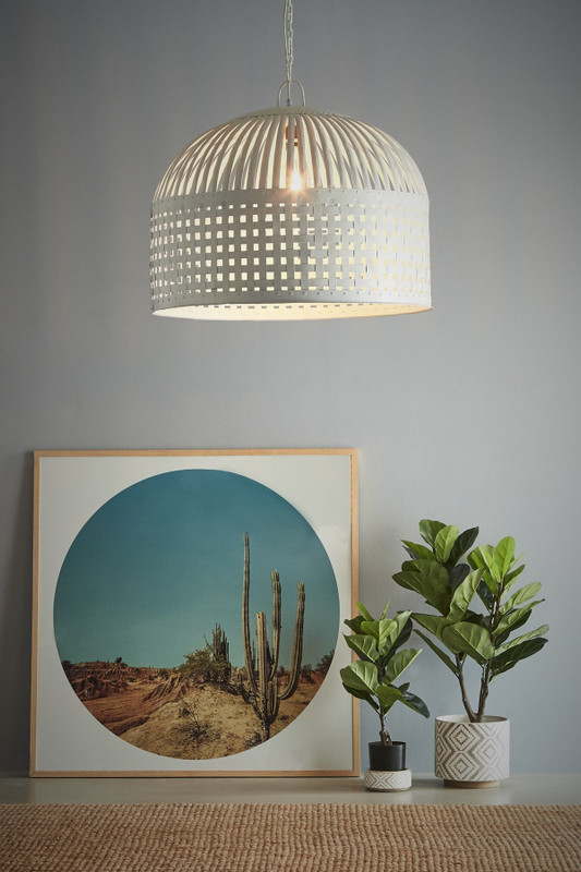 Cage Light features individual lengths of iron strips that are woven together and held in place by rivets, suspended beneath a graceful dome. Large