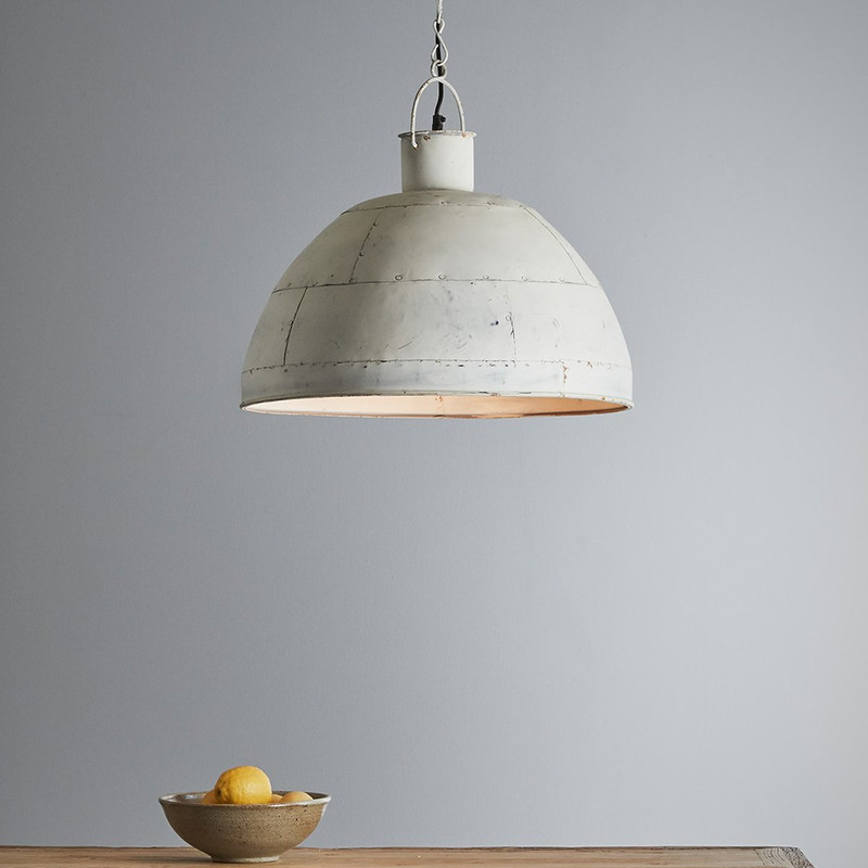 A riveted dome pendant in two rustic finishes. This pendant is designed to patina over time for a vintage aesthetic. Vintage white
