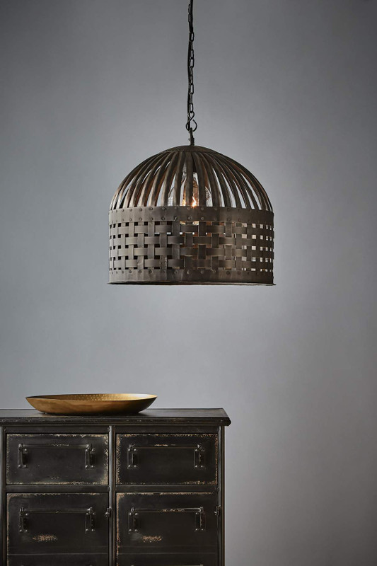 Cage light features individual lengths of iron strips that are woven together and held in place by rivets, suspended beneath a graceful dome. Medium