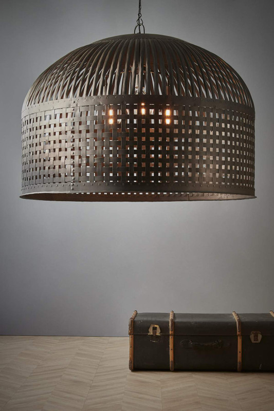 Cage light features individual lengths of iron strips that are woven together and held in place by rivets, suspended beneath a graceful dome. Extra Large