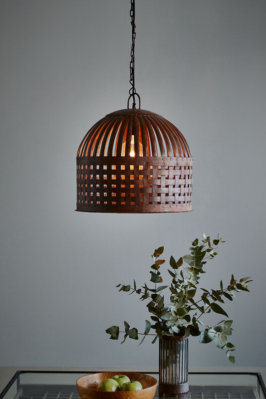 Esch features individual lengths of iron strips that are woven together and held in place by rivets, suspended beneath a graceful dome. Medium