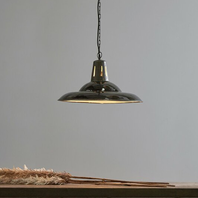 An enamel finished iron dish pendant light made exclusively in our workshops. Suitable for lower ceiling heights. Black