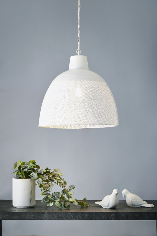 A rustic perforated pendant light with an industrial feel. This pendant is designed to patina over time for a vintage aesthetic. Large
