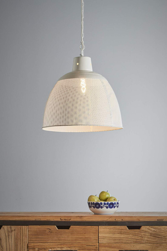 A rustic perforated pendant light with an industrial feel. This pendant is designed to patina over time for a vintage aesthetic. Medium