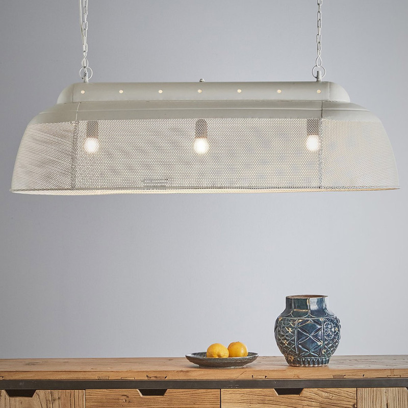 A rustic perforated pendant light with an industrial feel. This pendant is designed to patina over time for a vintage aesthetic.  Matt White
