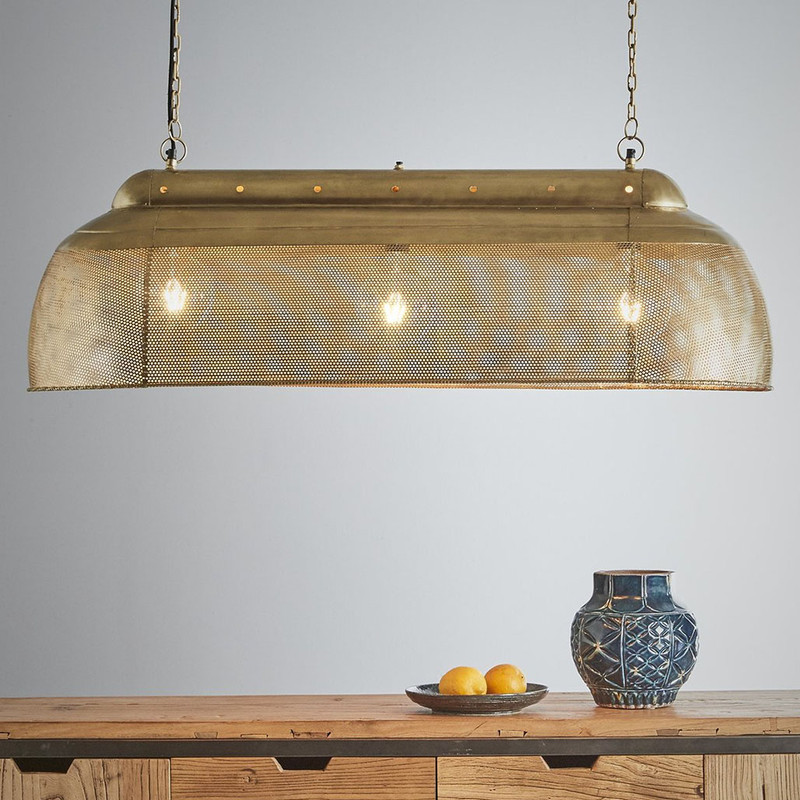 A rustic perforated pendant light with an industrial feel. This pendant is designed to patina over time for a vintage aesthetic.  Antique Brass
