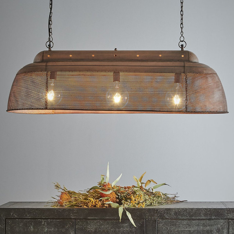 A rustic perforated pendant light with an industrial feel. This pendant is designed to patina over time for a vintage aesthetic.  Antique Copper