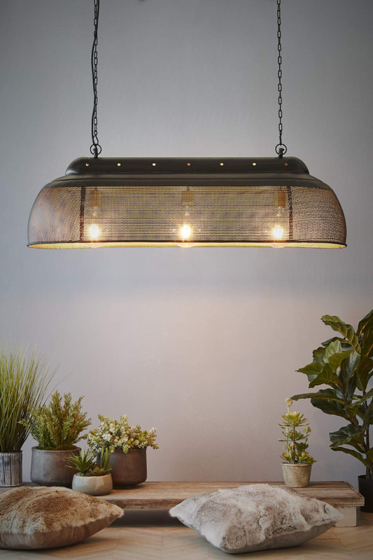 A rustic perforated pendant light with an industrial feel. This pendant is designed to patina over time for a vintage aesthetic.  Black and gold