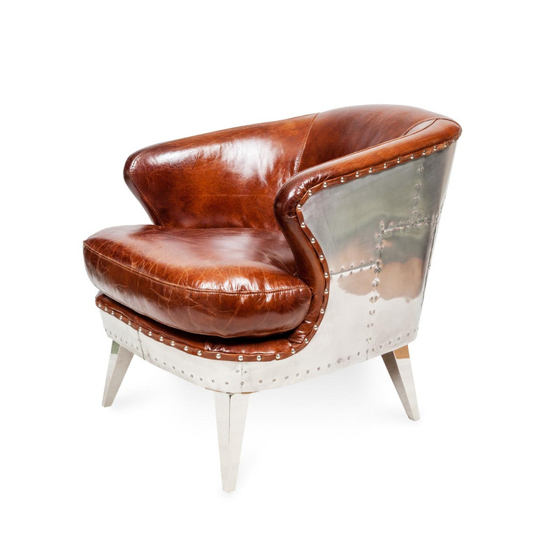 Aviator Leather Armchair - Striking industrial steam punk inspired brown aged leather armchair with aluminium sheeting and rivets. Settle in and relax, taking advantage of the wide deeply cushioned seat, curved back and premium vintage leather. Three quarter view left.