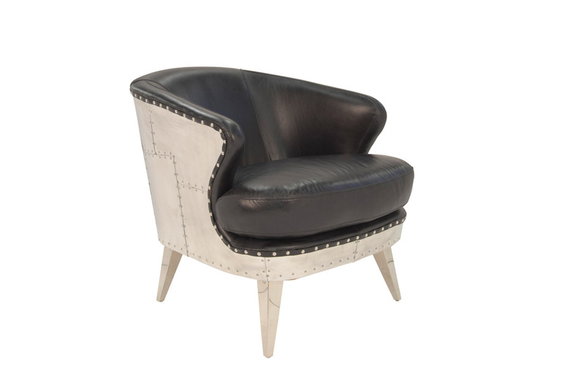 Aviator Leather Armchair - Striking industrial steam punk inspired black aged leather armchair with aluminium sheeting and rivets. Settle in and relax, taking advantage of the wide deeply cushioned seat, curved back and premium vintage leather. Three quarter view.