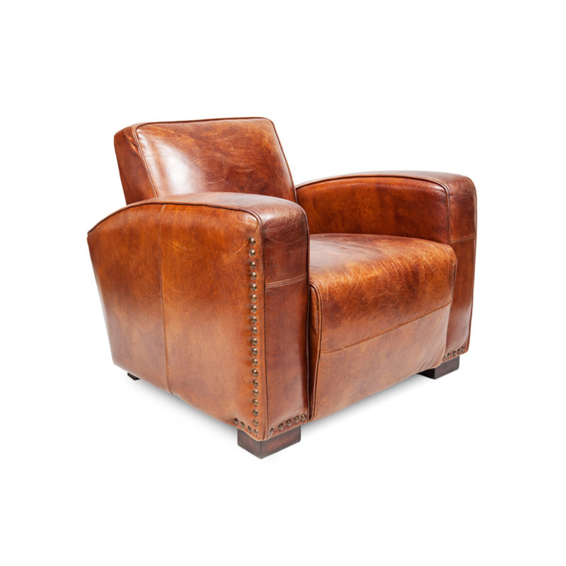 Oxley Club Chair - rich brown aged leather Gentleman's armchair. Channel the opulence of the deco era with the deep cushions, hand aged full grain leather and brass stud detailing of the Oxley Club Chair. Perfect as a library armchair, reading chair, or whiskey lounge armchair. 3/4 view.