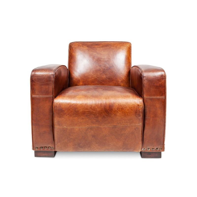 Oxley Club Chair - rich brown aged leather Gentleman's armchair. Channel the opulence of the deco era with the deep cushions, hand aged full grain leather and brass stud detailing of the Oxley Club Chair. Perfect as a library armchair, reading chair, or whiskey lounge armchair. Front view.