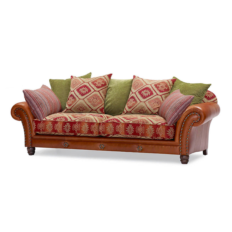 The Eastwood, a vintage-style sofa with Aztec-print cushion fabric and brass stud-work on the rolled arms, is supremely comfortable as you sink into its deep frame and feathery plushness. Front view