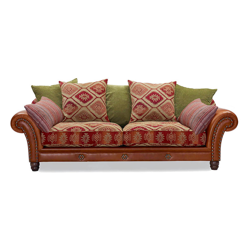 The Eastwood, a vintage-style sofa with Aztec-print cushion fabric and brass stud-work on the rolled arms, is supremely comfortable as you sink into its deep frame and feathery plushness. Angle view