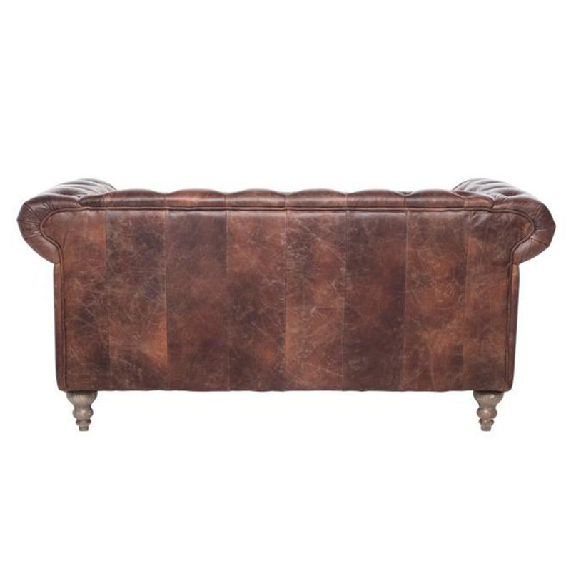 The Hampshire Chesterfield 2 seater sofa is a British classic. Upholstered in our signature Italian aged leather, iconic diamond buttoning, high rolled arms, brass stud detail and brass castors. The Hampshire is a timeless design to compliment any room. Back