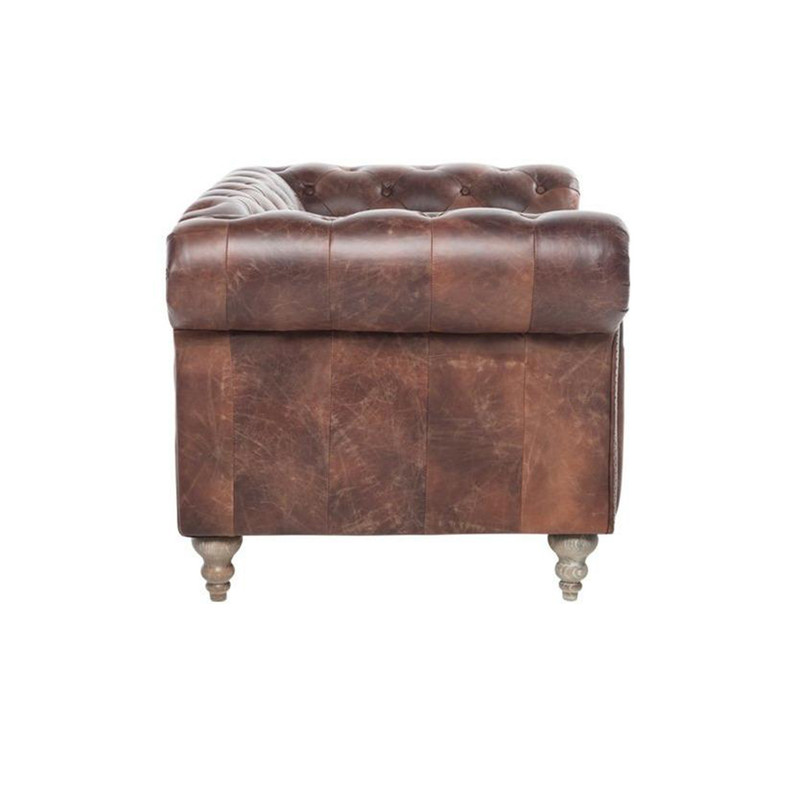 The Hampshire Chesterfield 2 seater sofa is a British classic. Upholstered in our signature Italian aged leather, iconic diamond buttoning, high rolled arms, brass stud detail and brass castors. The Hampshire is a timeless design to compliment any room. Side