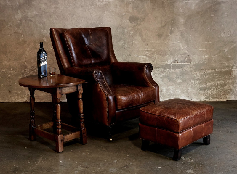 Sinclair Leather Armchair - The epitome of vintage style, this classic aged leather armchair has a regal personality that is reminiscent of men in smoking jackets, smoky libraries and times gone by. Matching leather ottoman also available, please enquire. Three quarter view (right).