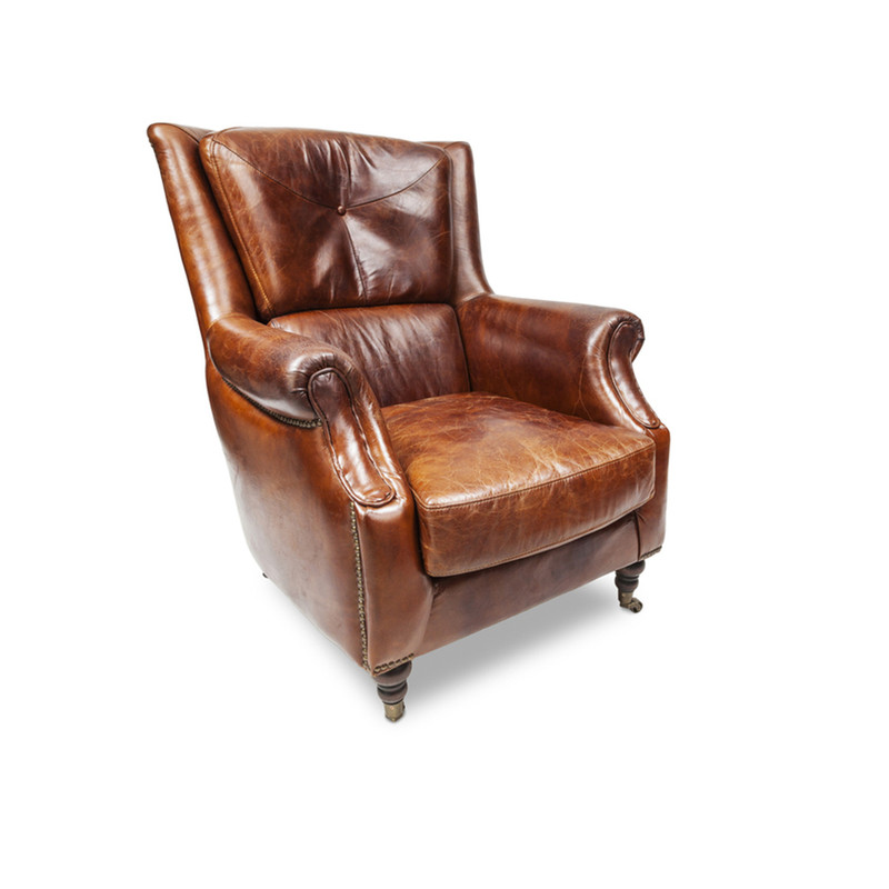 Sinclair Leather Armchair - The epitome of vintage style, this classic aged leather armchair has a regal personality that is reminiscent of men in smoking jackets, smoky libraries and times gone by. This vintage armchair makes a great accent piece, mix it up with more modern pieces or use it to compliment your existing vintage style furniture. Three quarter view (right).