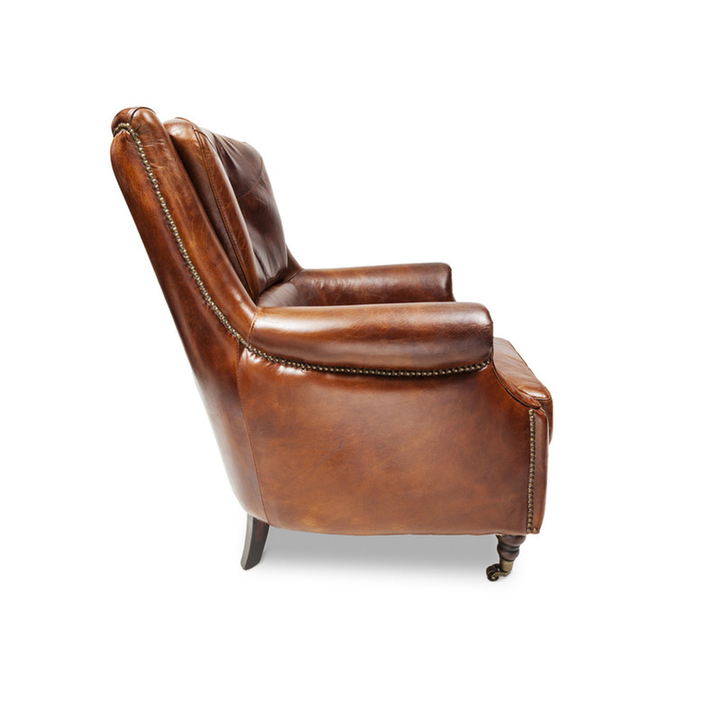 Sinclair Leather Armchair - The epitome of vintage style, this classic aged leather armchair has a regal personality that is reminiscent of men in smoking jackets, smoky libraries and times gone by. This vintage armchair makes a great accent piece, mix it up with more modern pieces or use it to compliment your existing vintage style furniture. Angle view right.