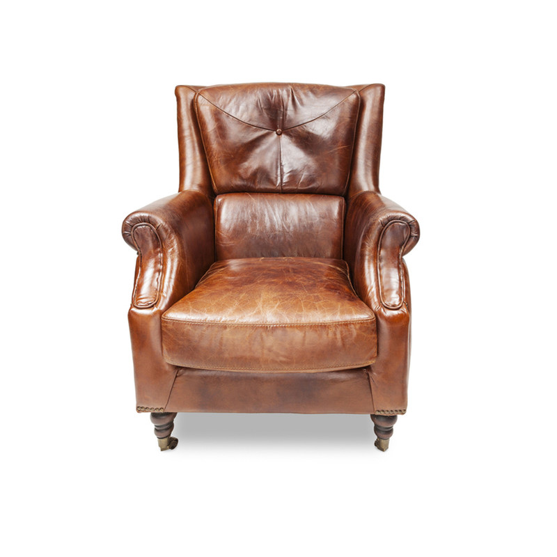 Sinclair Leather Armchair - The epitome of vintage style, this classic aged leather armchair has a regal personality that is reminiscent of men in smoking jackets, smoky libraries and times gone by. This vintage armchair makes a great accent piece, mix it up with more modern pieces or use it to compliment your existing vintage style furniture. Front view.